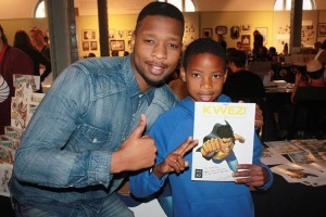 Loyiso-Mkize-with-a-young-reader-at-the-Comic-Fest