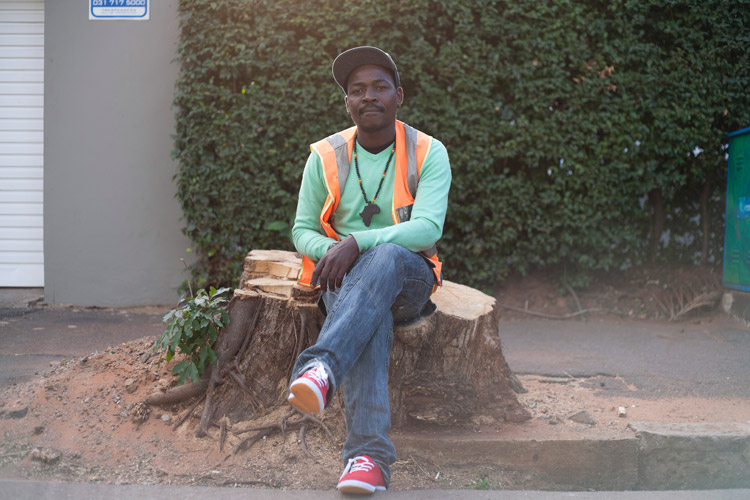 """I walk to work every morning from Umbilo to Florida Road (7kms). You'd be surprised to know that it's actually quicker than taking the bus! There's no traffic problems if you walk. I do want to get a driver's licence one day. But for now, I'm a car guard."" Eric Mthembu, Car Guard"