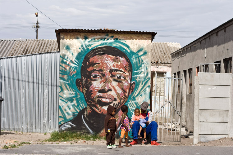 Father hangs out with his son after work. Artwork by Skubalisto. Langa, Cape Town